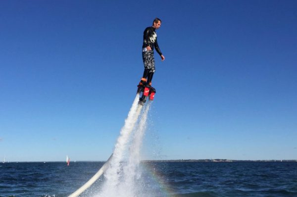 Practicing flyboard in Barcelona's coast