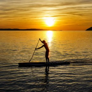 Paddle surf on sunset in Barcelona