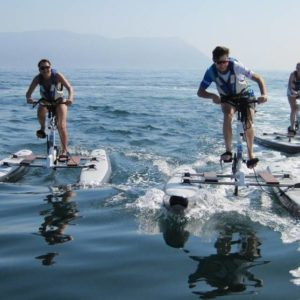 People practicing sport with a water bike